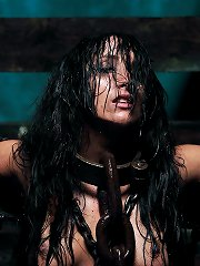 Busty diva is bound in massive chains