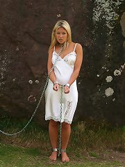 Cute model Belle chained to giant stone