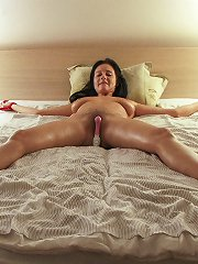 Enza is tied naked fully spread vibrating dildo on her h..
